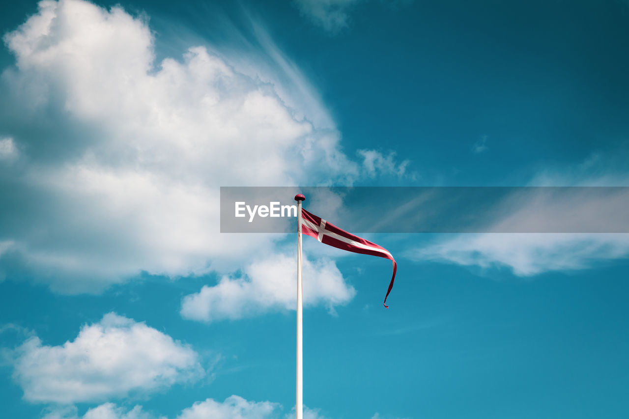 Low Angle View Of Flag Against Sky