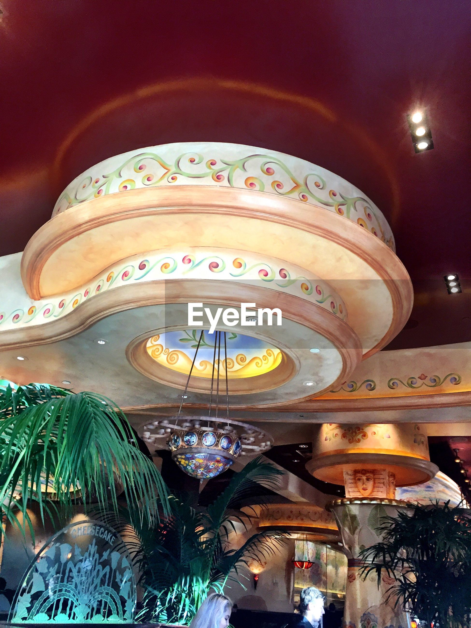 illuminated, low angle view, night, indoors, hanging, lighting equipment, built structure, no people, architecture, carousel