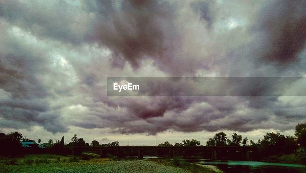 cloud - sky, dramatic sky, storm cloud, nature, cloudscape, storm, scenics, weather, beauty in nature, sky, tree, tranquil scene, tranquility, landscape, rural scene, outdoors, field, thunderstorm, day, no people, agriculture, sunset, tornado