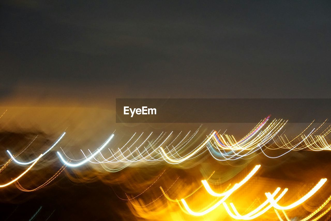 glowing, illuminated, long exposure, night, blurred motion, motion, light trail, heat - temperature, speed, burning, no people, flame, outdoors, pattern, sky, nature, close-up