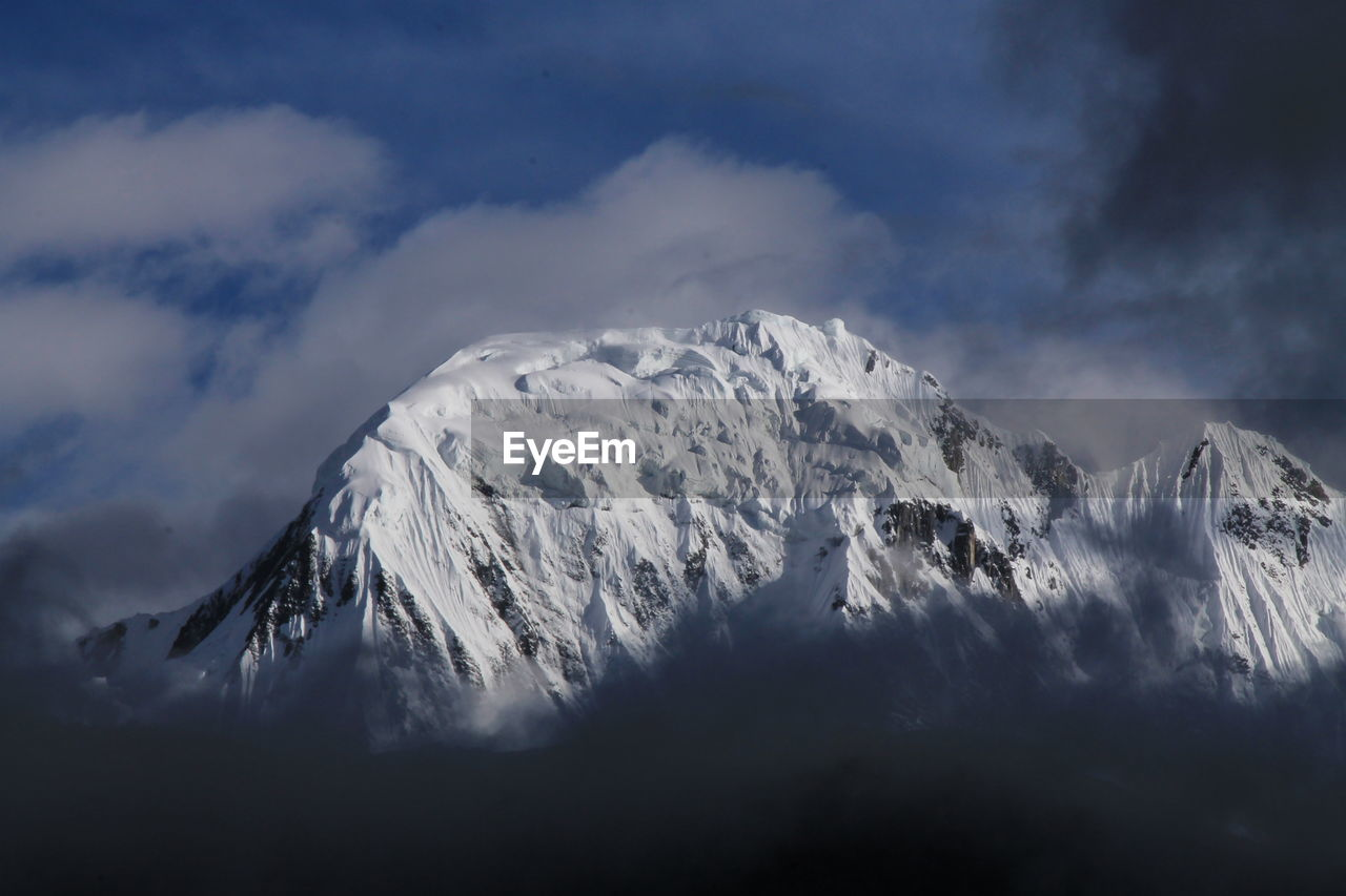 Majestic view of dhaulagiri snowcapped mountains against sky