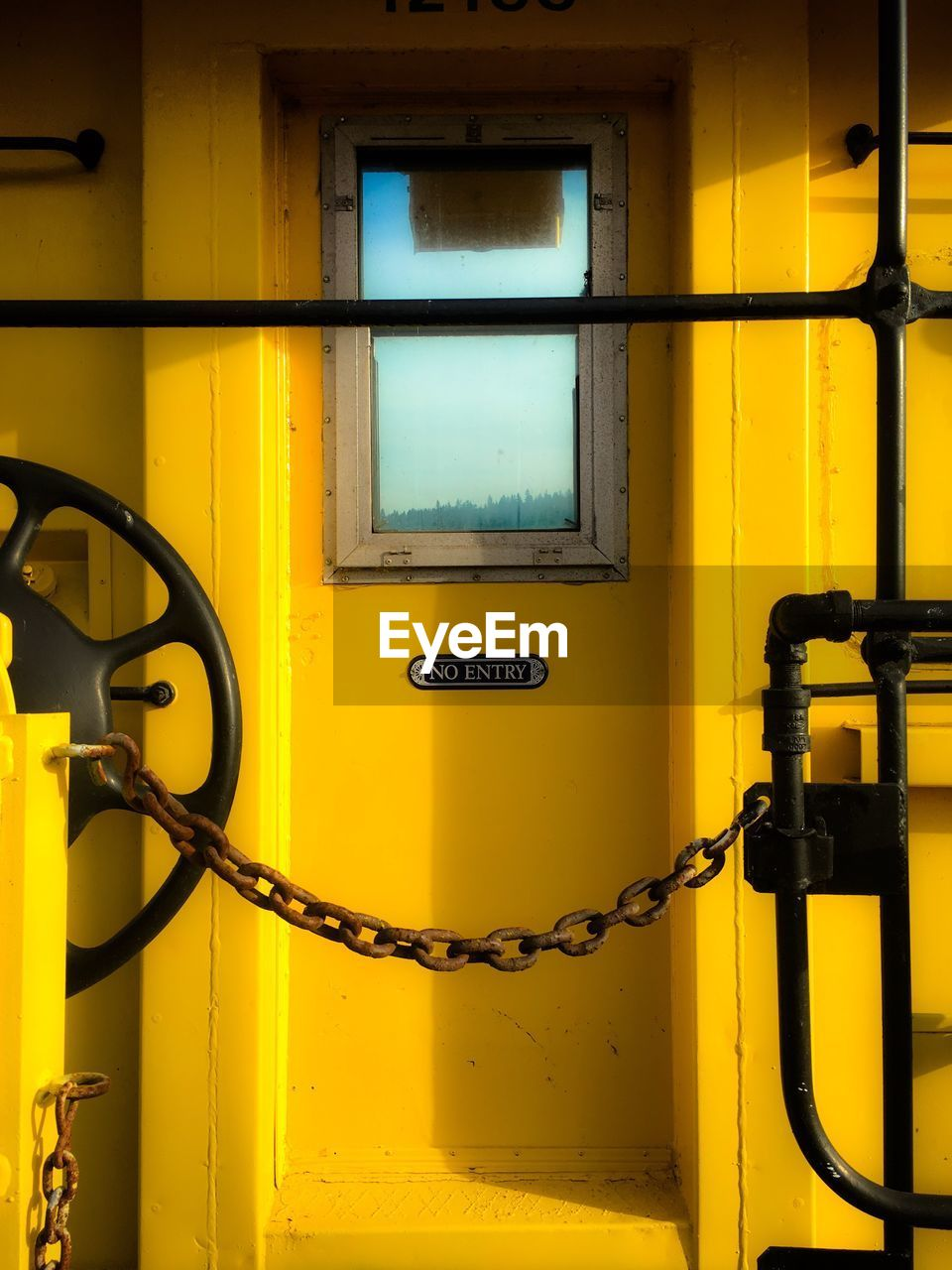 yellow, no people, fuel and power generation, window, architecture, connection, technology, security, close-up, indoors, protection, safety, communication, metal, day, built structure, illuminated, wall - building feature, refueling, power supply