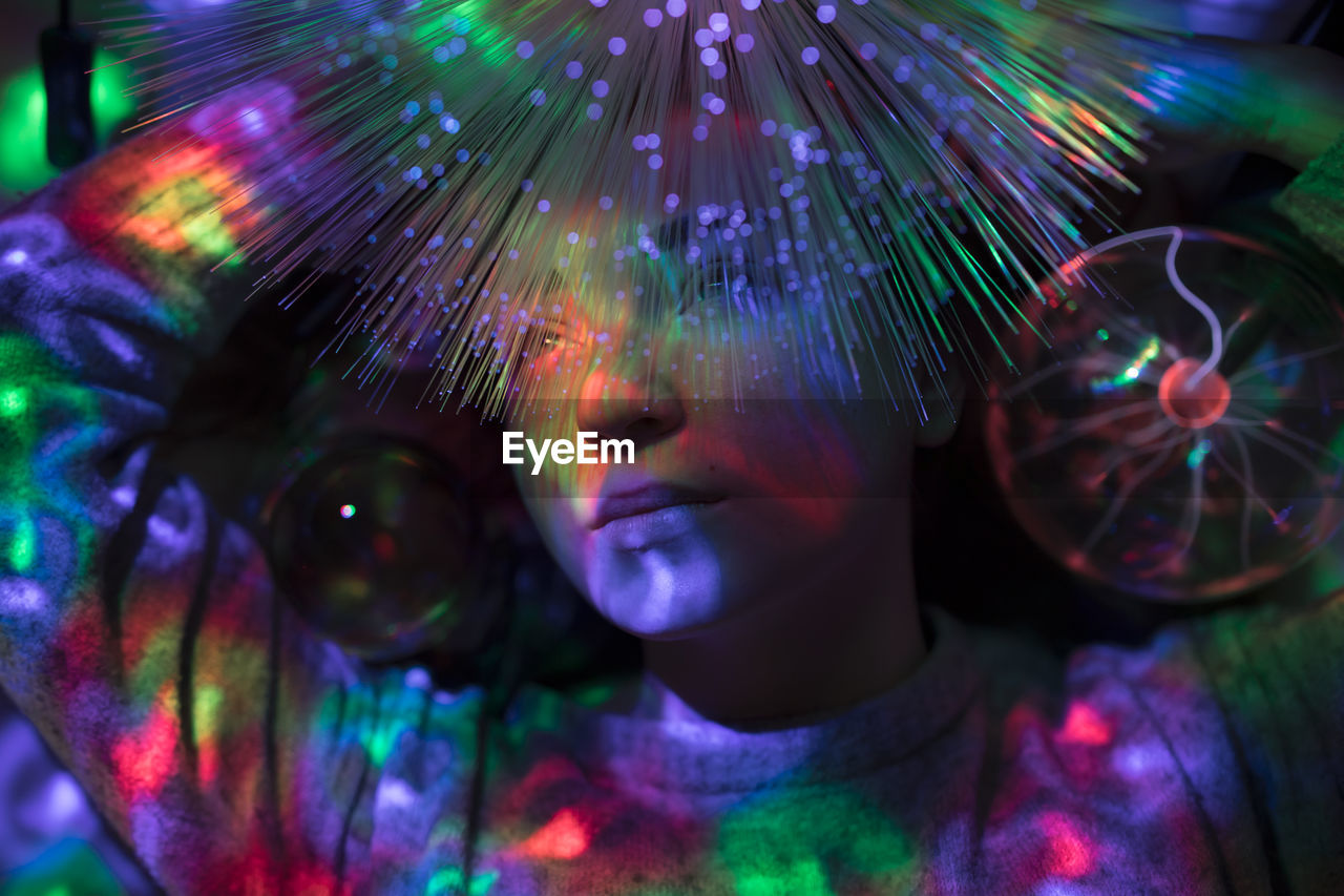 multi colored, close-up, indoors, pattern, front view, one person, illuminated, real people, headshot, portrait, celebration, glowing, digital composite, looking, lifestyles, nature, purple