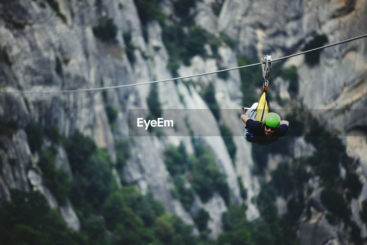 Close-Up Of Man Hanging On Wire