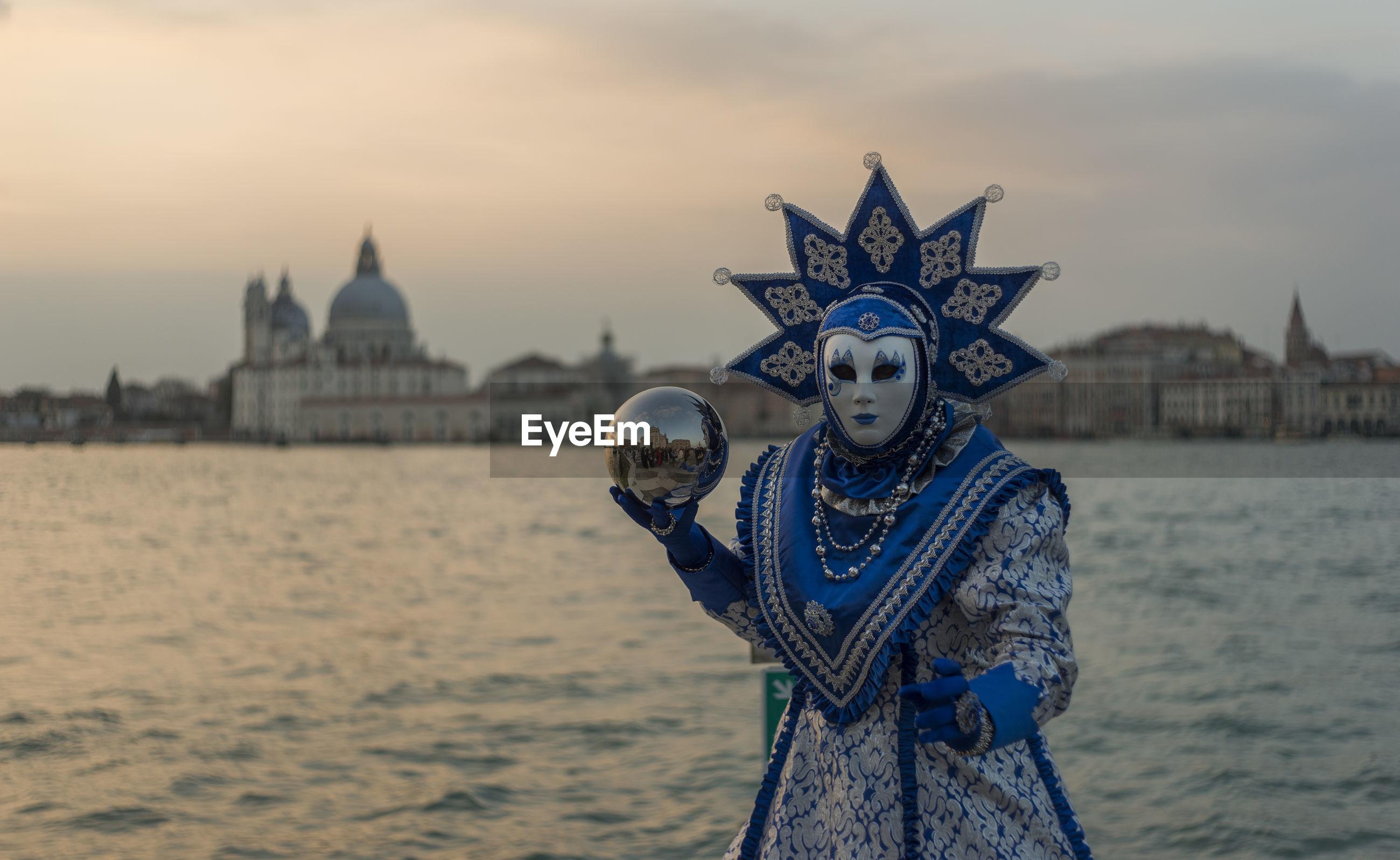 Carnival mask against sky during sunset venice