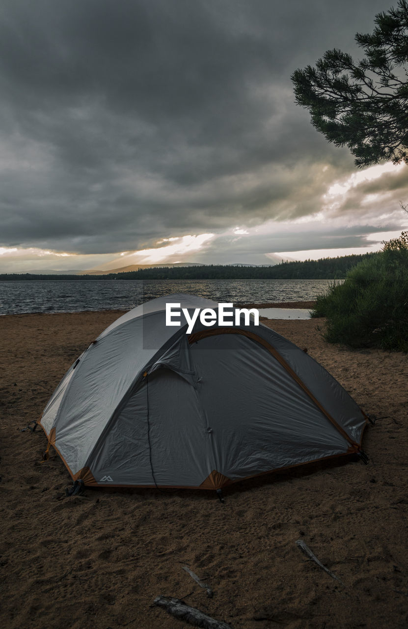 cloud - sky, sky, land, beach, nature, beauty in nature, water, scenics - nature, sea, camping, sunset, sand, tranquil scene, tent, tranquility, no people, non-urban scene, horizon over water, outdoors