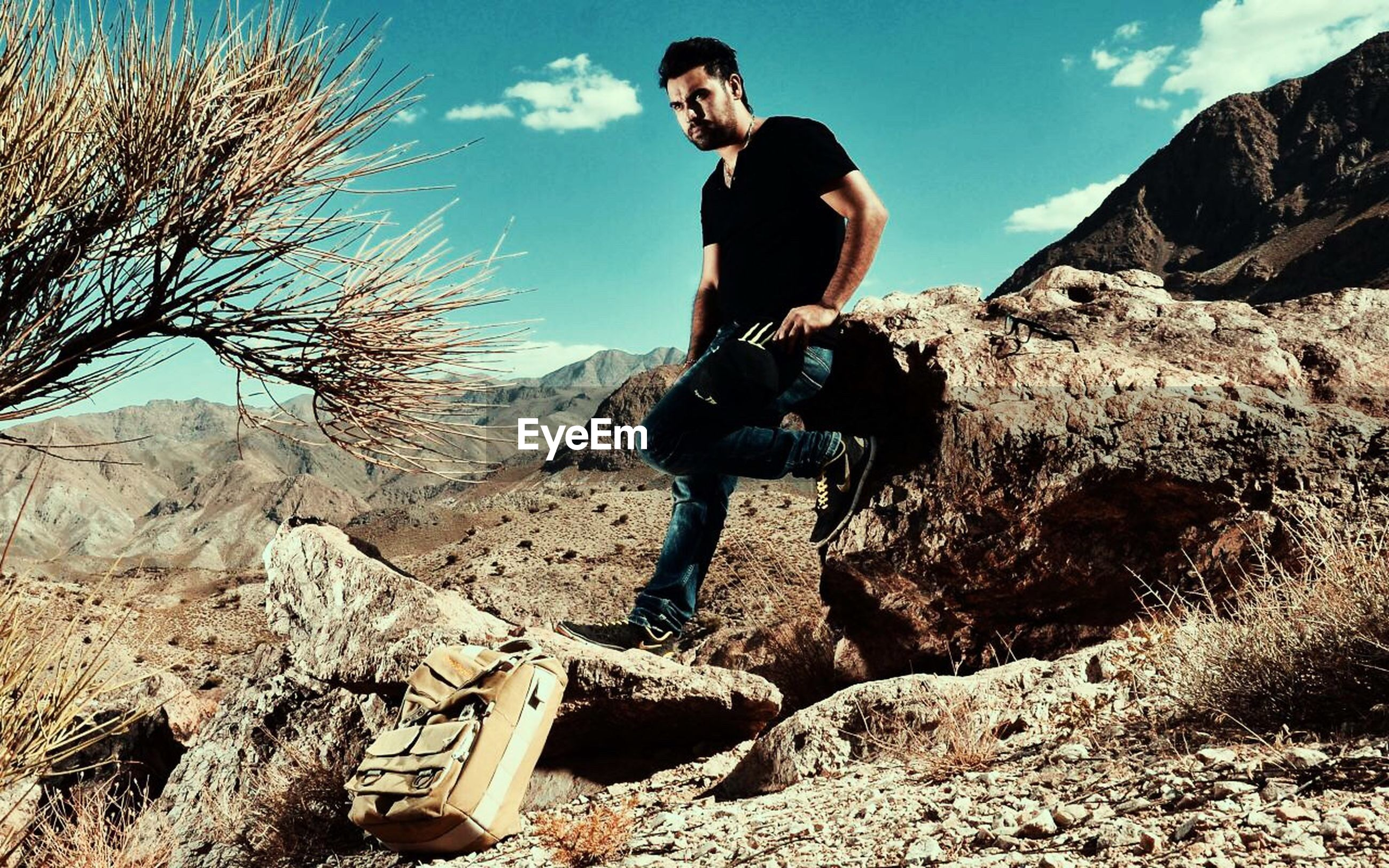 rock - object, one person, real people, full length, adventure, nature, sky, day, young men, young adult, outdoors, lifestyles, men, mountain, beauty in nature, tree, extreme sports, one man only, people