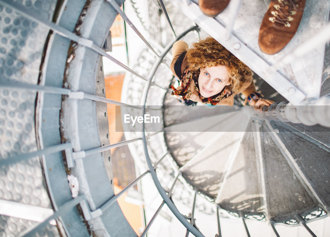 women, real people, portrait, people, young adult, adult, day, young women, females, emotion, metal, smiling, leisure activity, transportation, lifestyles, high angle view, two people, focus on foreground, outdoors, wheel