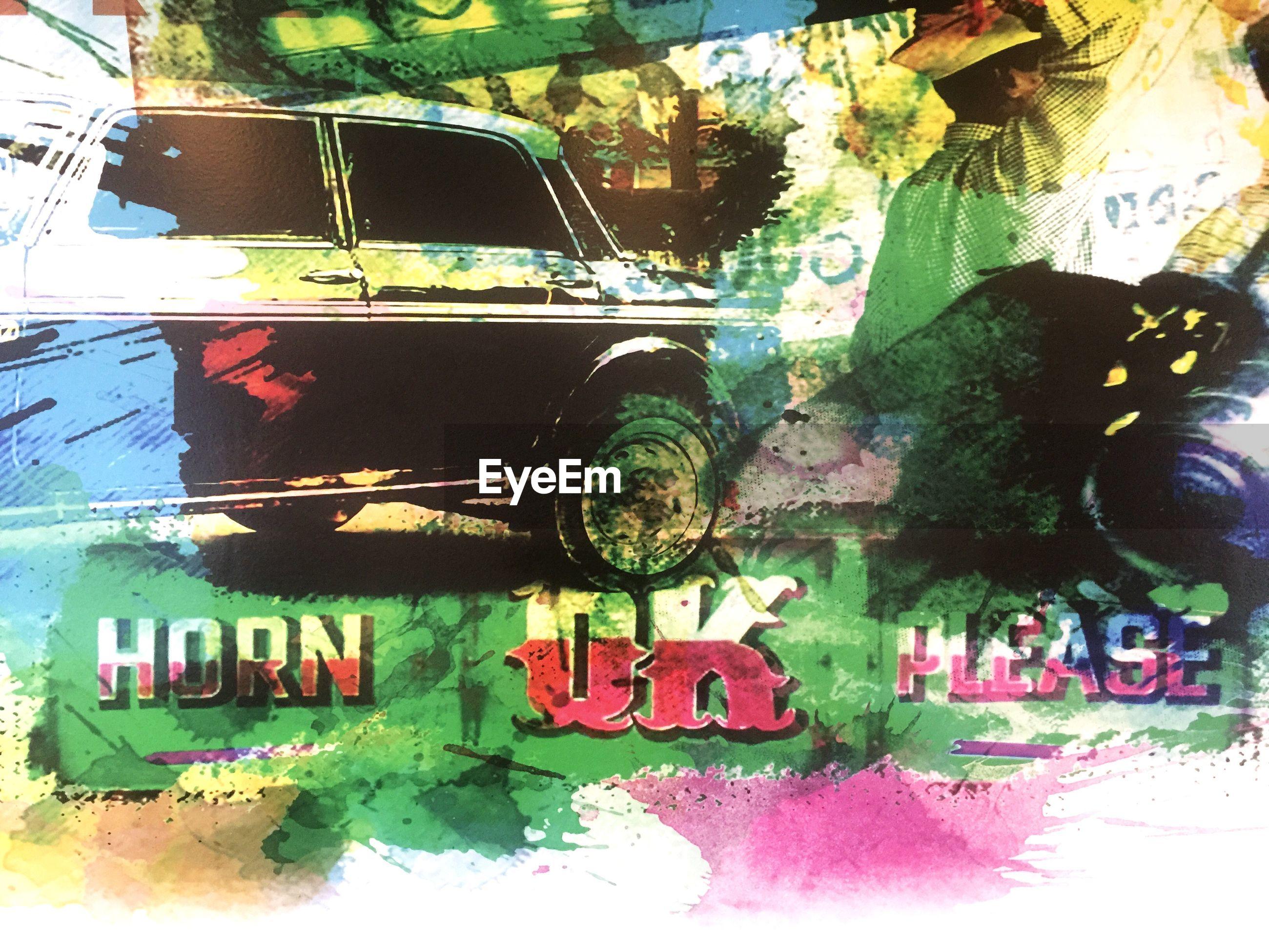 HIGH ANGLE VIEW OF GRAFFITI ON CAR