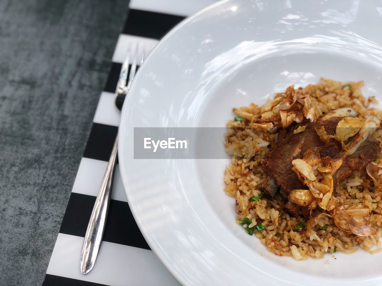 plate, food and drink, food, ready-to-eat, table, still life, freshness, eating utensil, indoors, serving size, kitchen utensil, no people, wellbeing, close-up, rice - food staple, healthy eating, spoon, fork, meal, high angle view, dinner, temptation, garnish, crockery