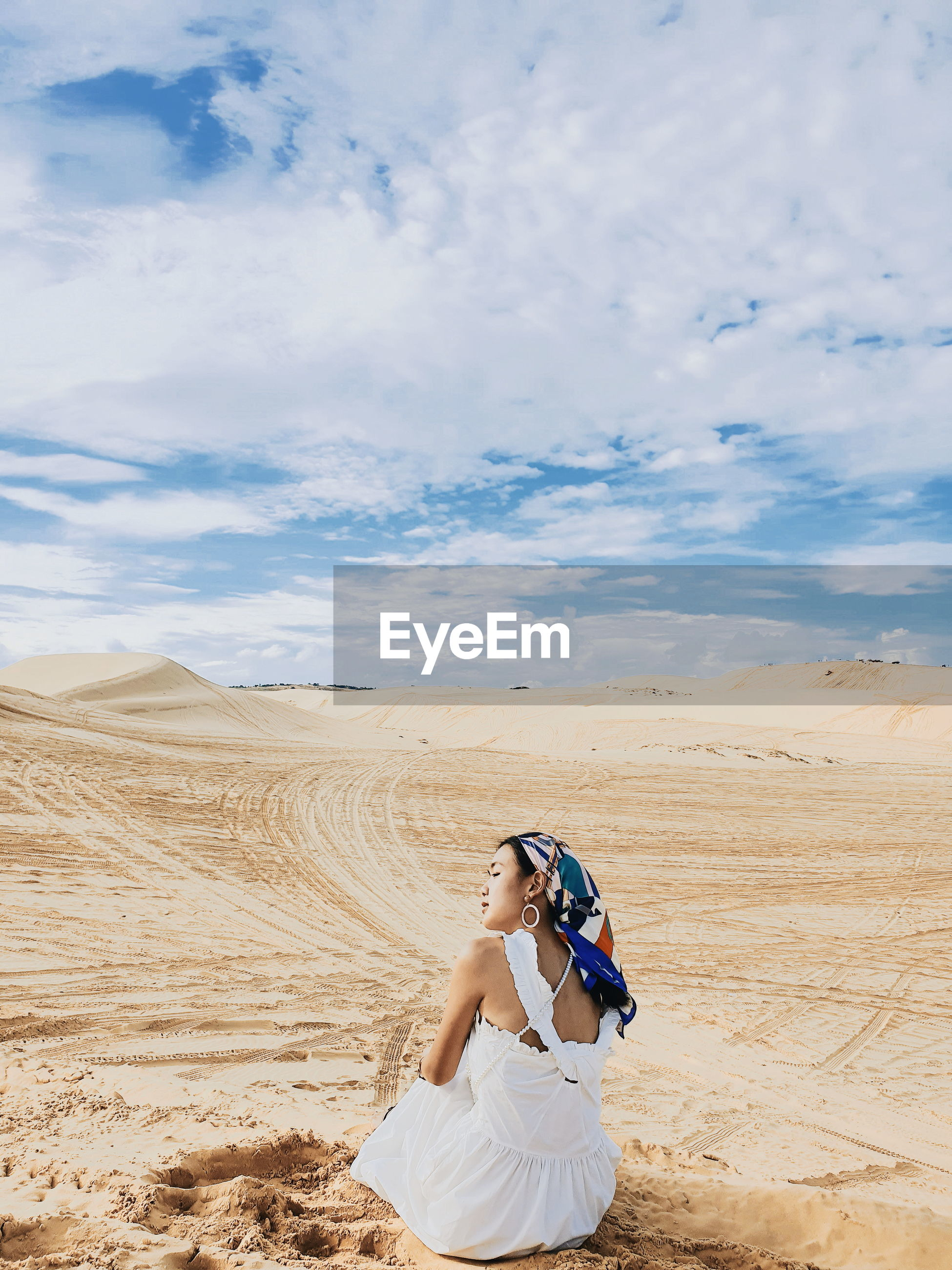 Woman photographing on desert