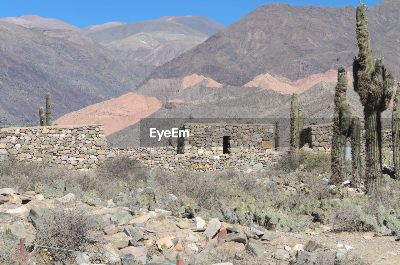 mountain, architecture, built structure, building exterior, building, the past, history, mountain range, nature, scenics - nature, no people, house, landscape, day, residential district, old ruin, old, sky, environment, ancient, outdoors, ancient civilization, ruined, deterioration, arid climate