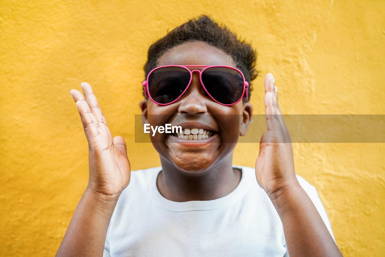 Portrait Of Smiling Boy Wearing Sunglasses
