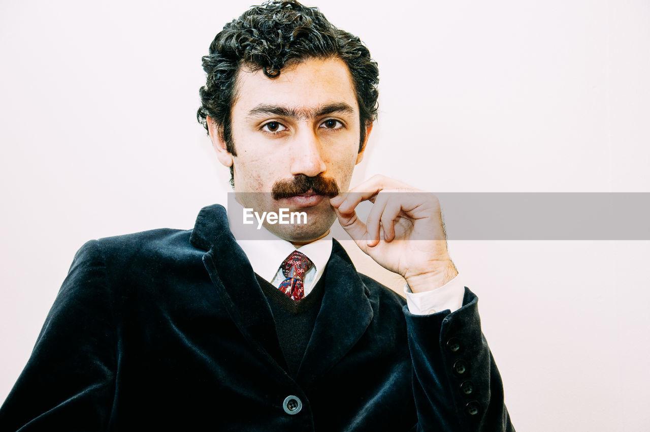 Portrait of man against white background