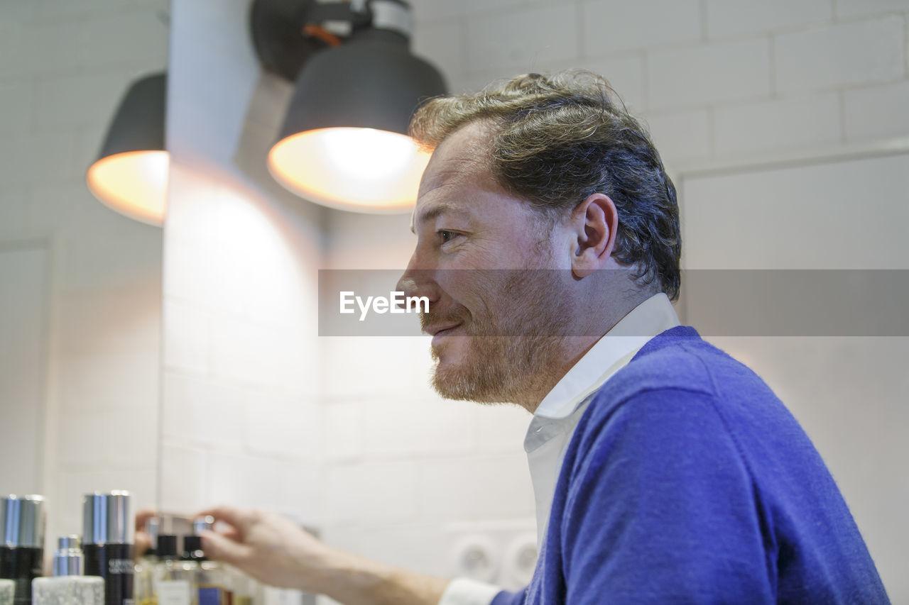 Close-up of man looking away at home