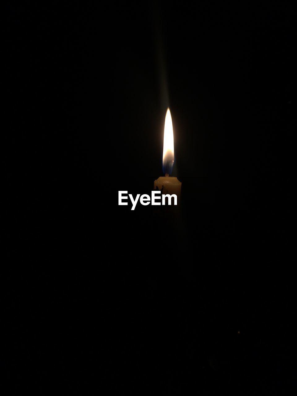 flame, burning, heat - temperature, candle, glowing, darkroom, copy space, illuminated, no people, studio shot, close-up, black background, night, indoors, diya - oil lamp
