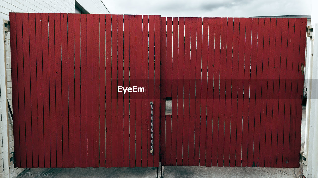 wood - material, red, day, architecture, safety, entrance, door, built structure, no people, security, metal, protection, outdoors, closed, building exterior, nature, container, pattern, close-up, brown, cabin, corrugated