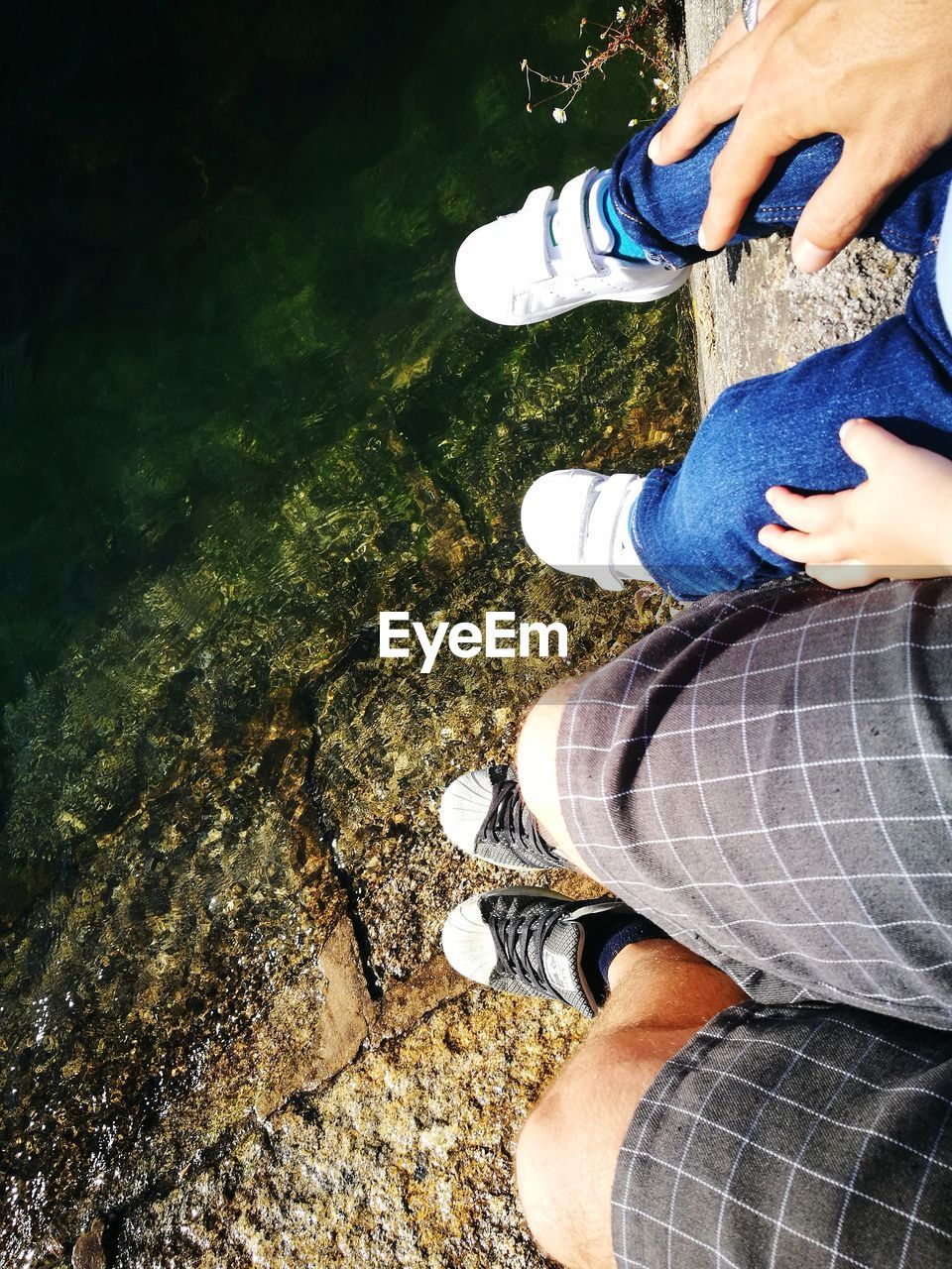 low section, real people, human leg, standing, high angle view, lifestyles, people, leisure activity, body part, shoe, human body part, day, nature, women, adult, casual clothing, men, two people, outdoors, jeans, human foot