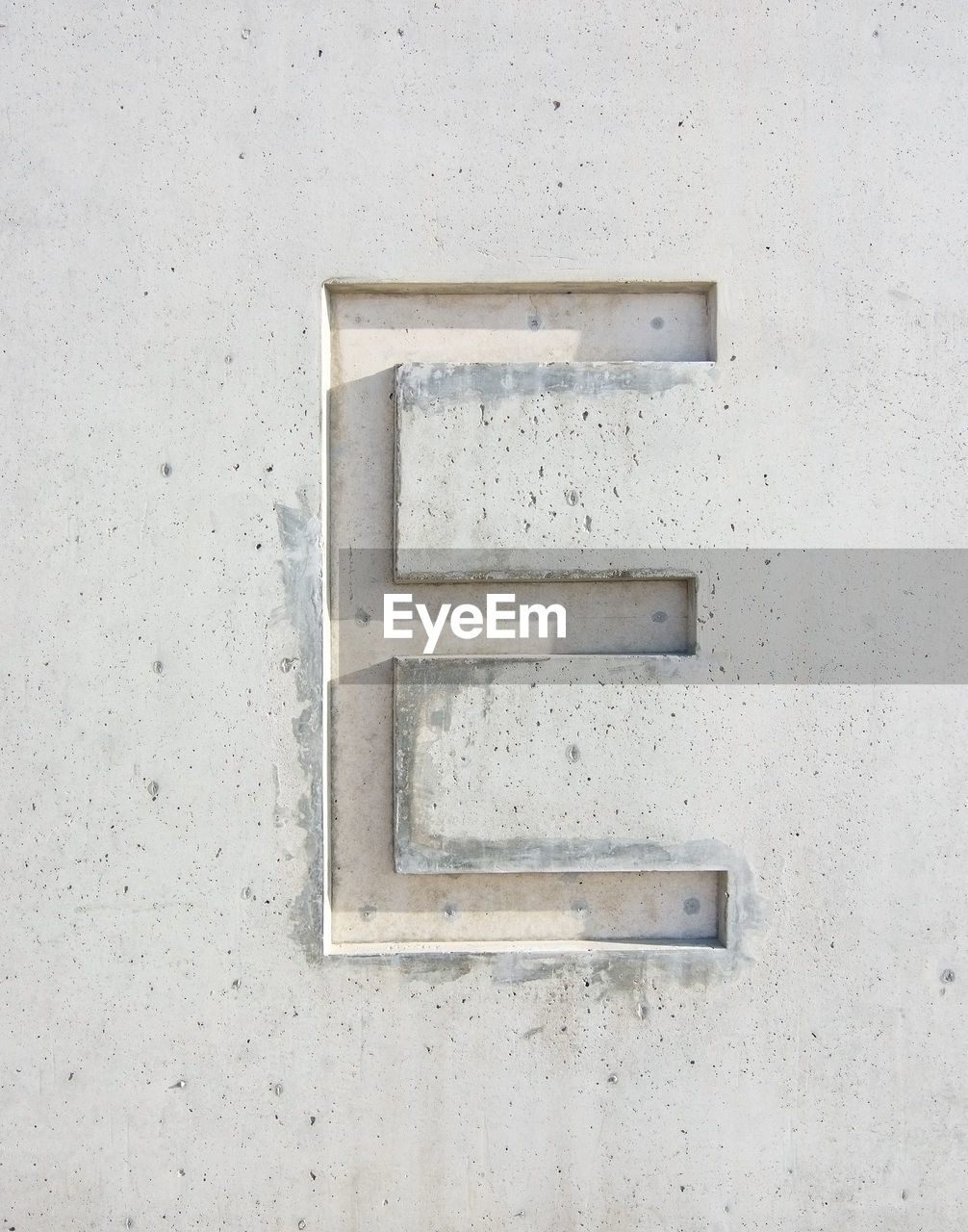 Close-Up Of Letter E On White Wall