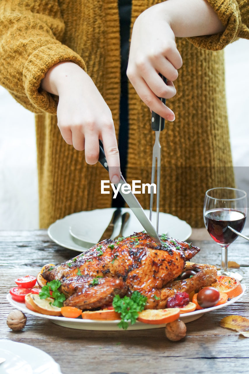 Midsection of woman preparing food on table