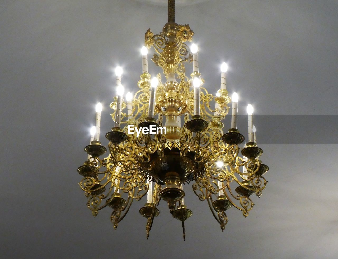 illuminated, chandelier, lighting equipment, hanging, glowing, ceiling, low angle view, no people, decoration, electricity, indoors, luxury, light, wealth, ornate, electric light, pendant light, crystal, design, close-up, electric lamp, light fixture
