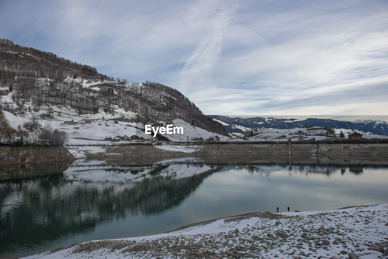 cold temperature, winter, water, sky, scenics - nature, snow, mountain, beauty in nature, cloud - sky, tranquil scene, tranquility, mountain range, no people, nature, environment, day, reflection, landscape, snowcapped mountain, ice, outdoors, iceberg