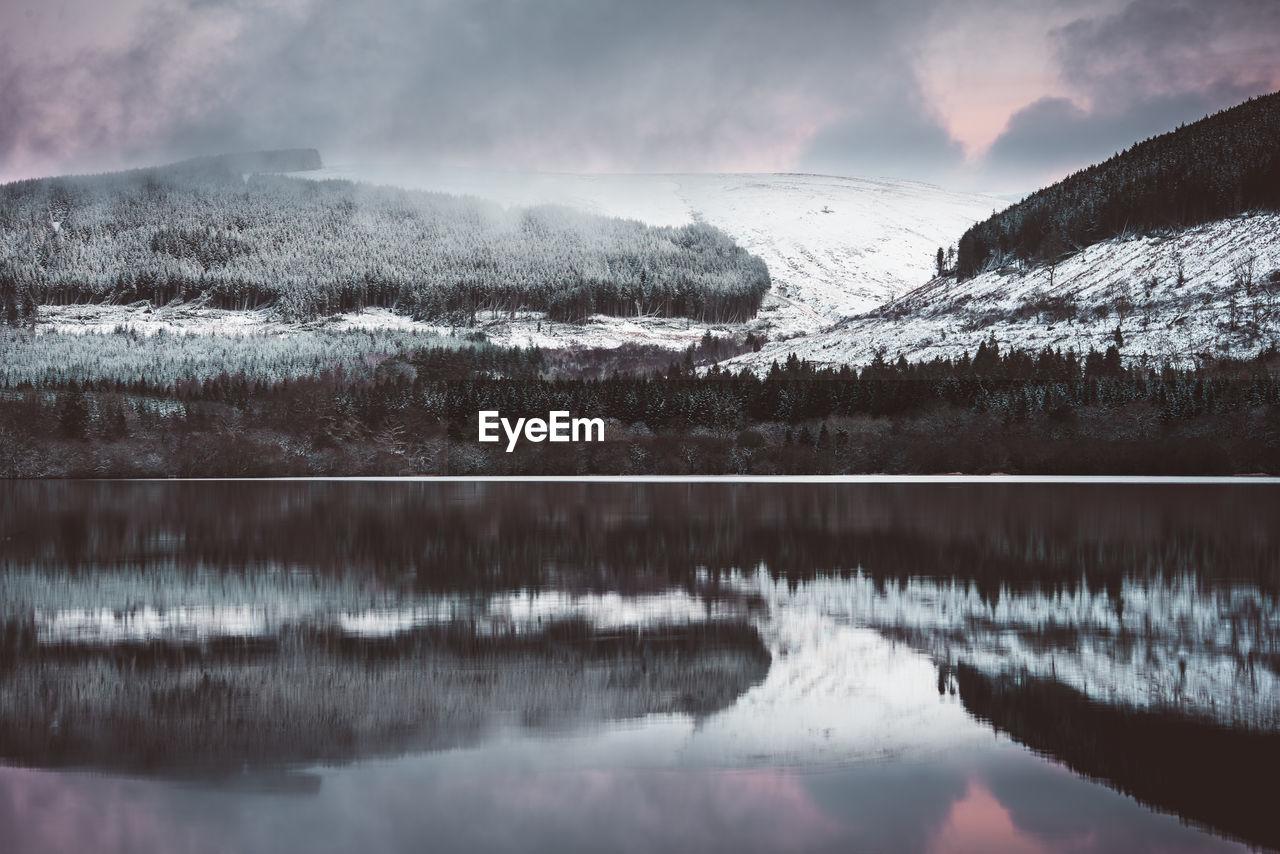 Snowcapped Mountain Reflecting On Calm Lake