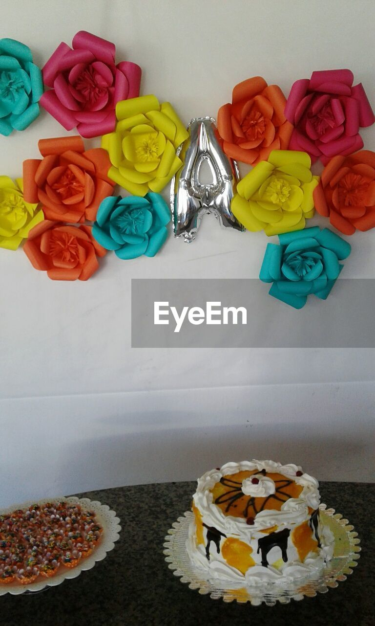 sweet food, multi colored, food and drink, flower, dessert, no people, food, variation, indoors, indulgence, unhealthy eating, table, freshness, cupcake, close-up, ready-to-eat, day