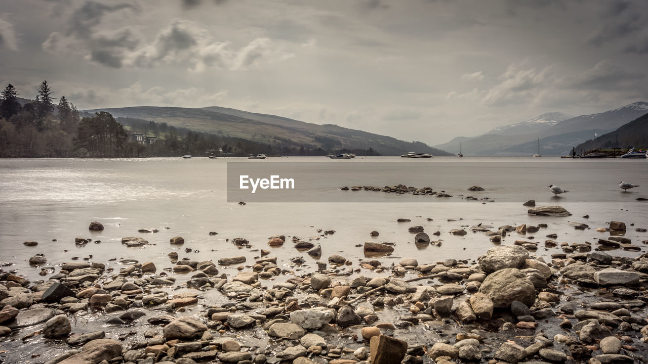 water, cloud - sky, scenics - nature, beauty in nature, sky, mountain, rock, tranquility, tranquil scene, nature, solid, rock - object, no people, day, non-urban scene, sea, land, beach