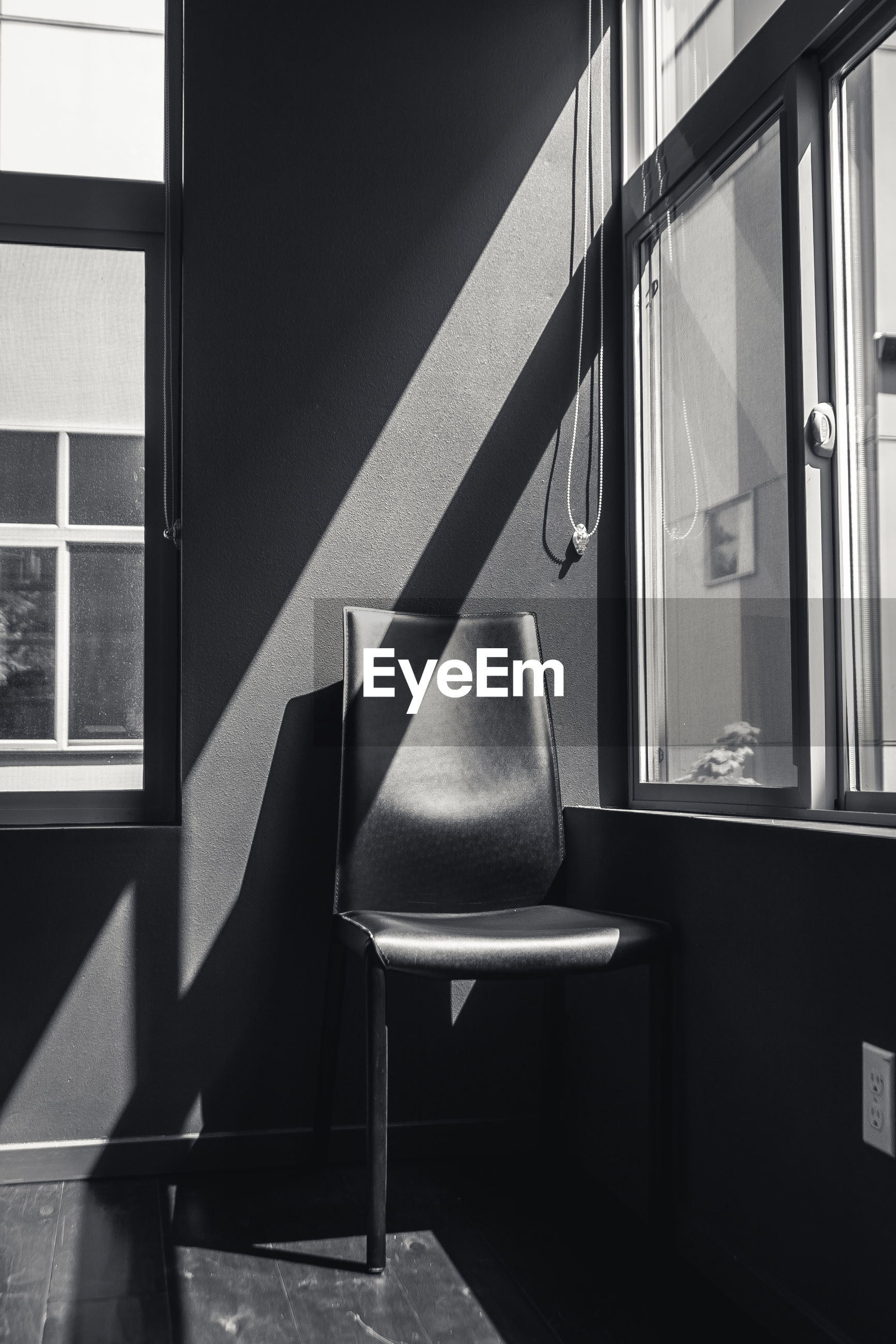 Empty chair by window at home