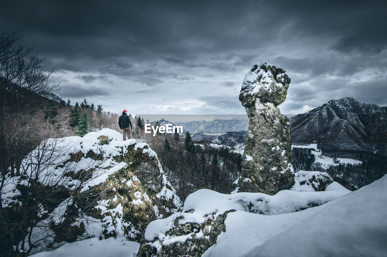 snow, cold temperature, winter, cloud - sky, sky, beauty in nature, scenics - nature, nature, tranquil scene, tranquility, mountain, day, real people, leisure activity, environment, white color, non-urban scene, outdoors, storm, extreme weather, snowcapped mountain