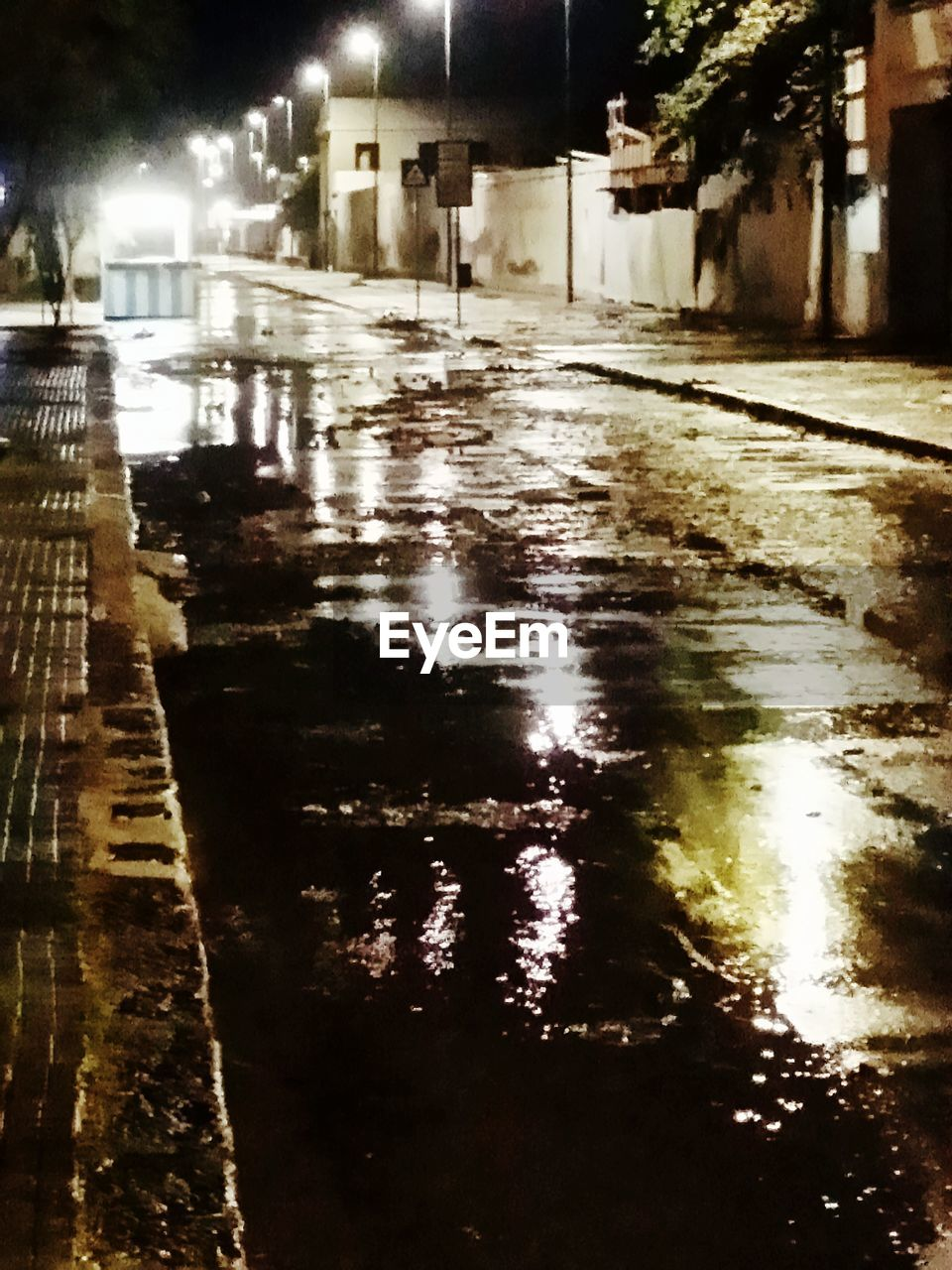 illuminated, architecture, city, night, street, building exterior, water, built structure, wet, road, reflection, rain, transportation, no people, building, the way forward, nature, direction, puddle, outdoors, rainy season