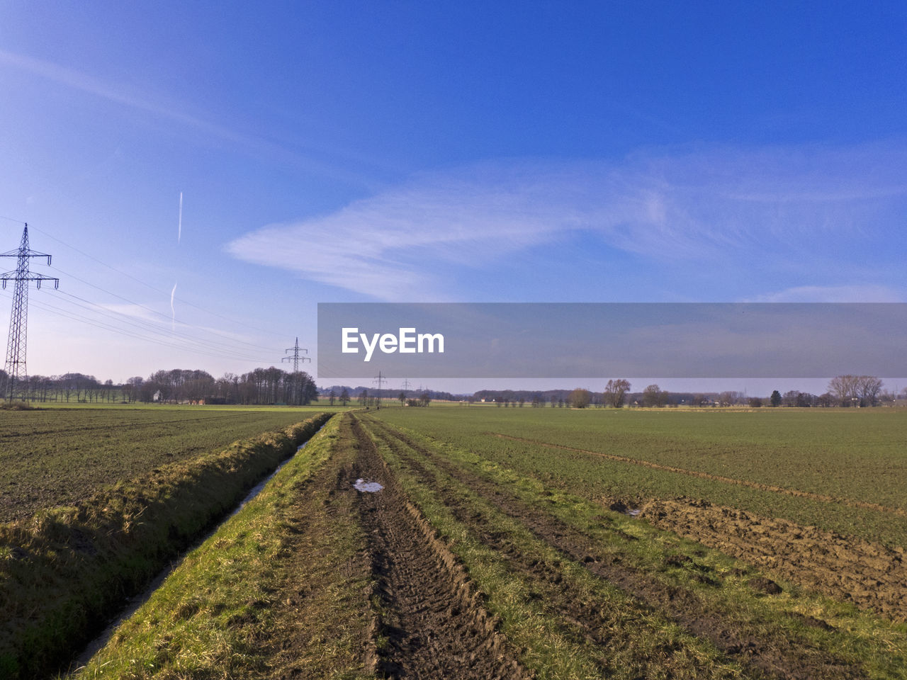 field, agriculture, rural scene, landscape, tranquil scene, day, nature, no people, fuel and power generation, tranquility, sky, beauty in nature, outdoors, scenics, wind turbine, wind power, industrial windmill, windmill