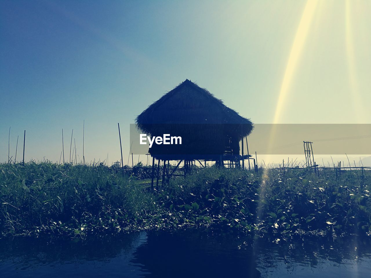 thatched roof, water, nature, summer, beauty in nature, outdoors, no people, clear sky, sea, day, scenics, sky