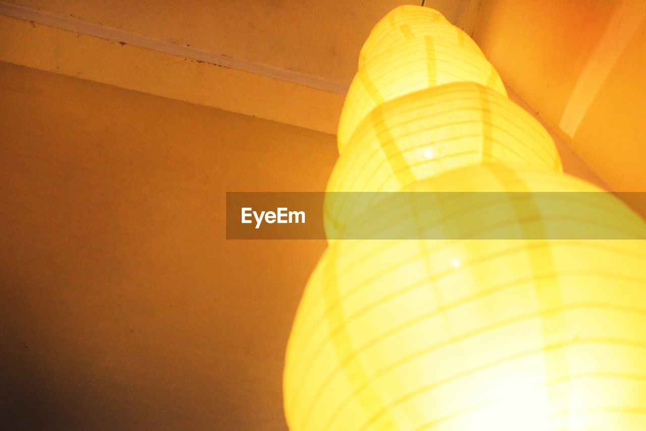 low angle view, lighting equipment, no people, indoors, close-up, electricity, illuminated, yellow, day, architecture