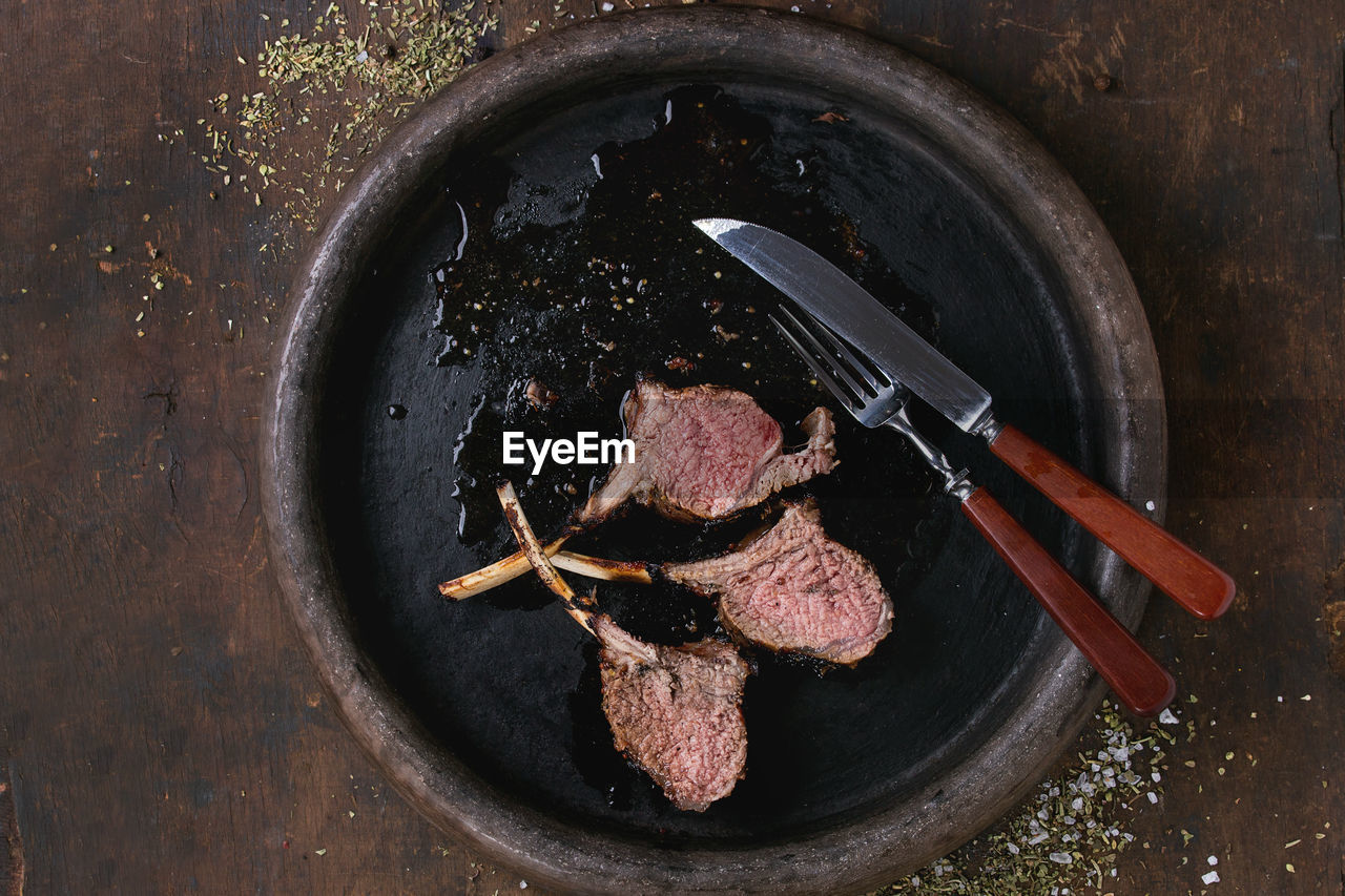 High angle view of grilled meat in cooking pan