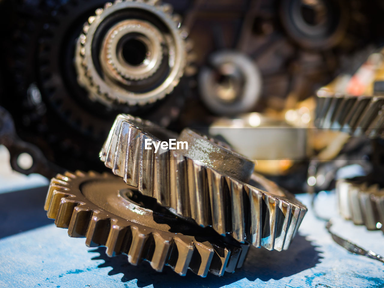 Close-up of machine gears on table