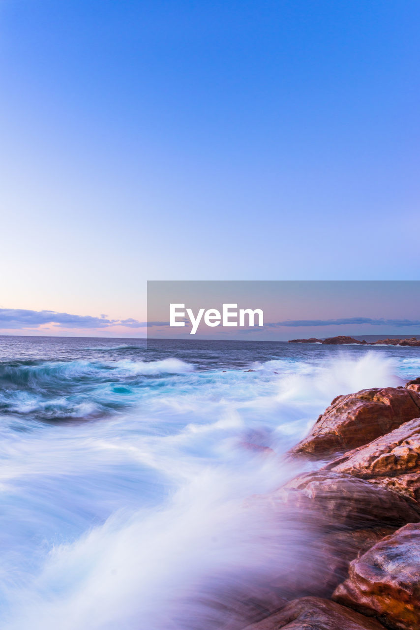 sea, sky, water, beauty in nature, scenics - nature, beach, motion, sunset, land, wave, rock, horizon over water, tranquility, no people, horizon, nature, copy space, clear sky, rock - object, outdoors, power in nature
