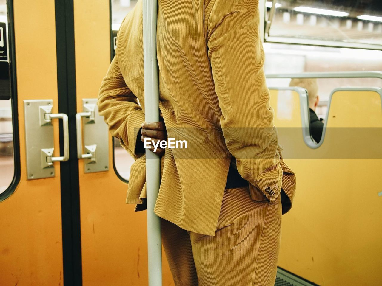 Midsection Of Man Traveling In Train