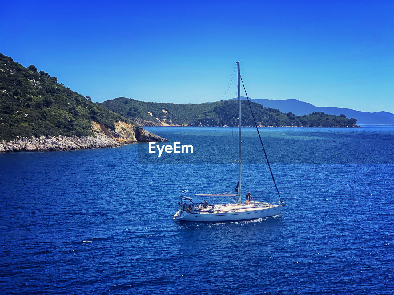 nautical vessel, water, sea, transportation, mode of transportation, sky, scenics - nature, beauty in nature, blue, sailboat, mountain, sailing, day, waterfront, tranquil scene, clear sky, nature, tranquility, no people, outdoors, yacht, yachting, luxury