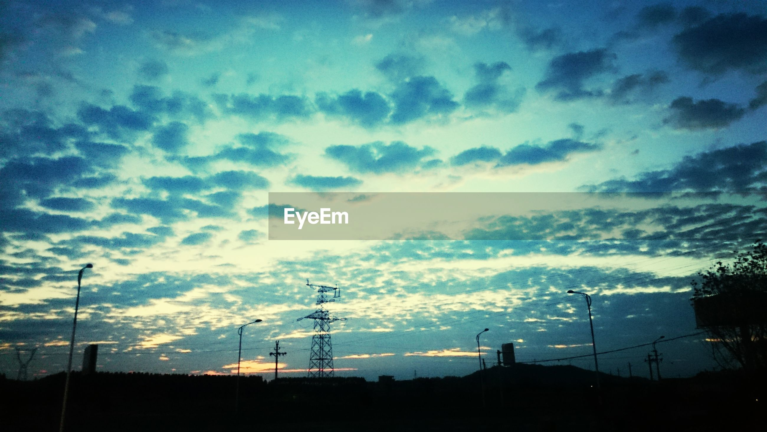 silhouette, sky, electricity pylon, fuel and power generation, sunset, electricity, power line, cloud - sky, power supply, technology, low angle view, beauty in nature, scenics, nature, landscape, tranquility, cloud, dusk, tranquil scene, cloudy