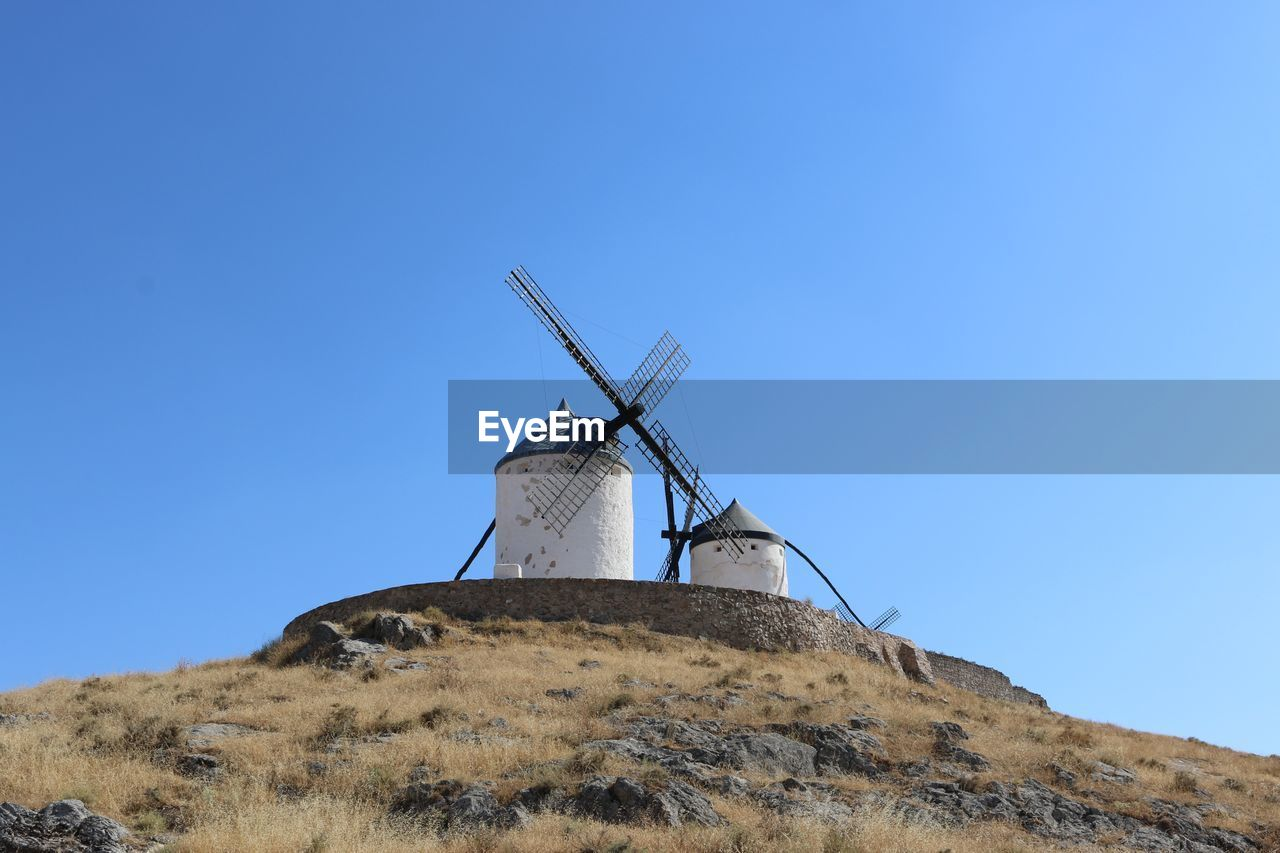 sky, alternative energy, wind turbine, environmental conservation, wind power, environment, turbine, renewable energy, fuel and power generation, clear sky, blue, low angle view, copy space, traditional windmill, nature, day, landscape, land, no people, blade, outdoors