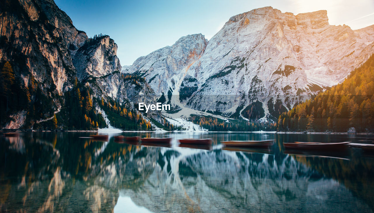mountain, water, lake, beauty in nature, scenics - nature, sky, cold temperature, reflection, nature, mountain range, waterfront, tranquility, tranquil scene, winter, snow, no people, landscape, environment, idyllic, mountain peak, formation, snowcapped mountain
