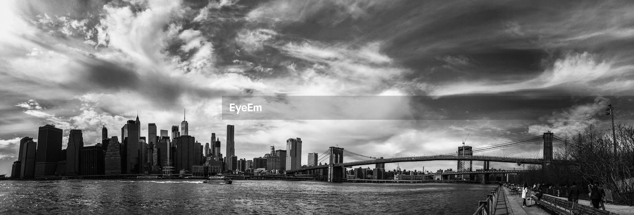 Panoramic View Of City Against Cloudy Sky