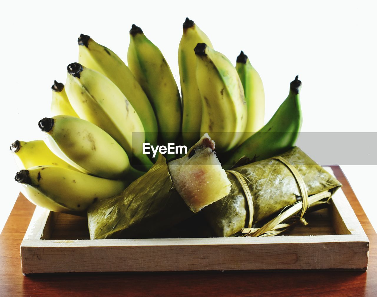 food and drink, healthy eating, still life, food, freshness, studio shot, wellbeing, banana, white background, indoors, fruit, close-up, no people, wood - material, table, group of objects, green color, large group of objects, cut out, ripe, tray