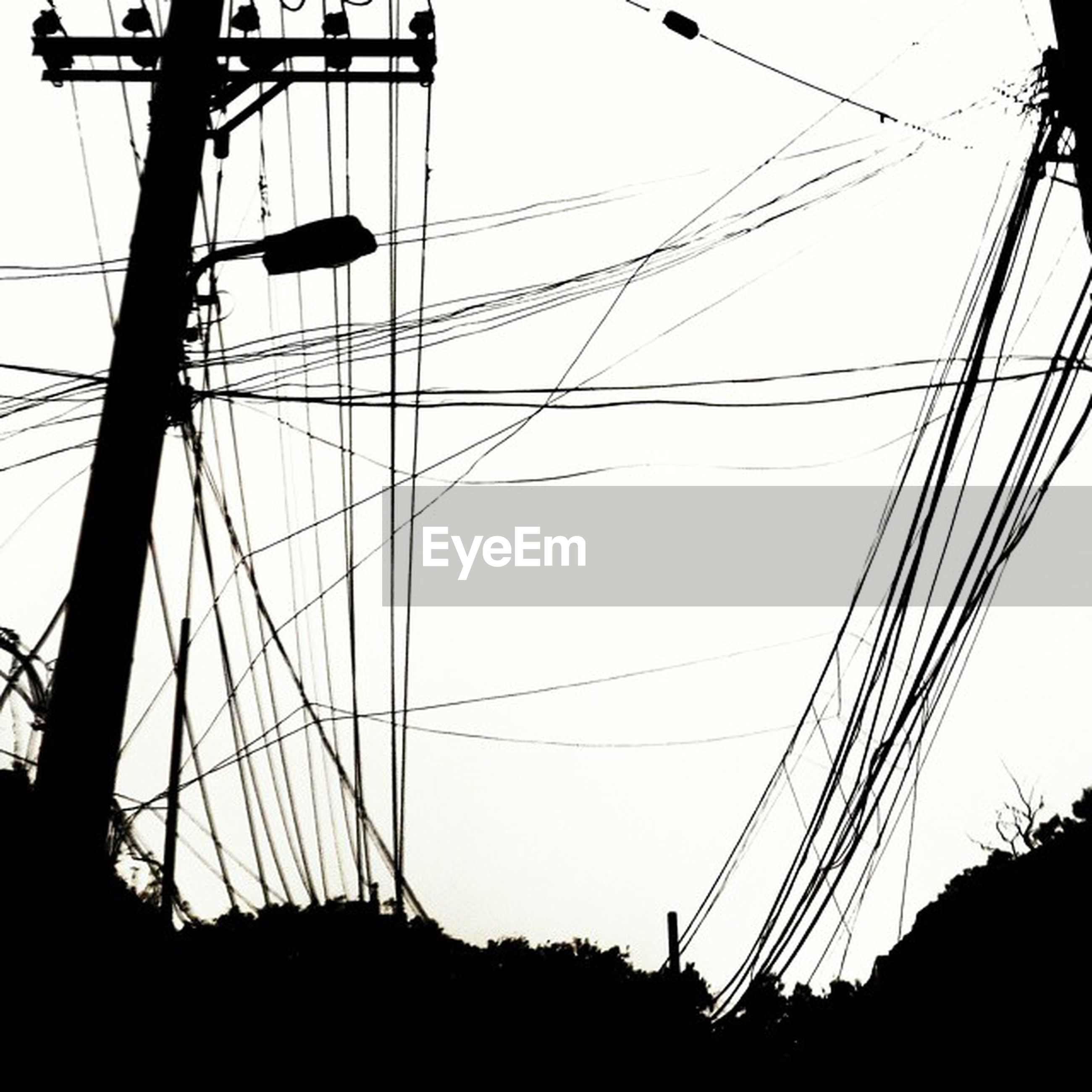 power line, electricity pylon, power supply, electricity, cable, connection, low angle view, technology, silhouette, fuel and power generation, sky, clear sky, power cable, transportation, telephone pole, outdoors, telephone line, dusk, electricity tower, complexity