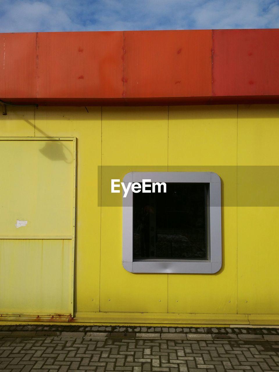 CLOSE UP OF YELLOW WALL