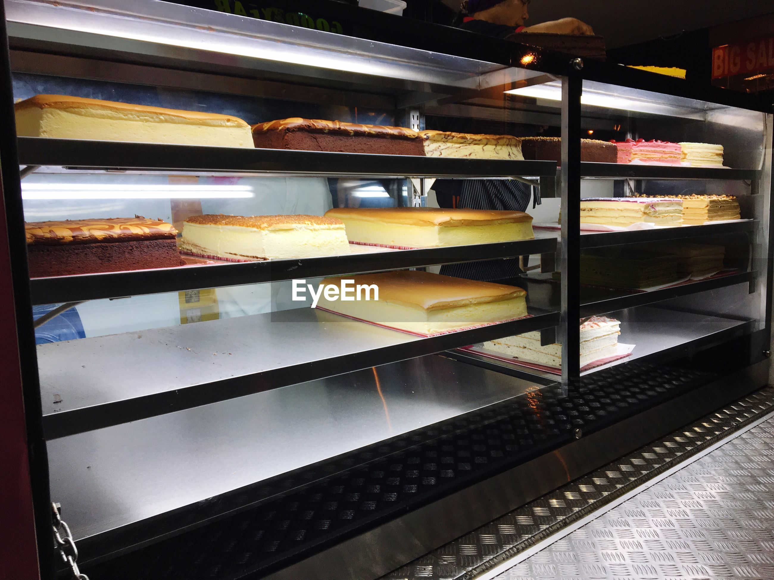 food and drink, sweet food, food, indulgence, indoors, dessert, variation, store, shelf, unhealthy eating, retail, choice, freshness, temptation, macaroon, bakery, display cabinet, no people, ready-to-eat, consumerism, close-up, ice cream parlor, supermarket, day
