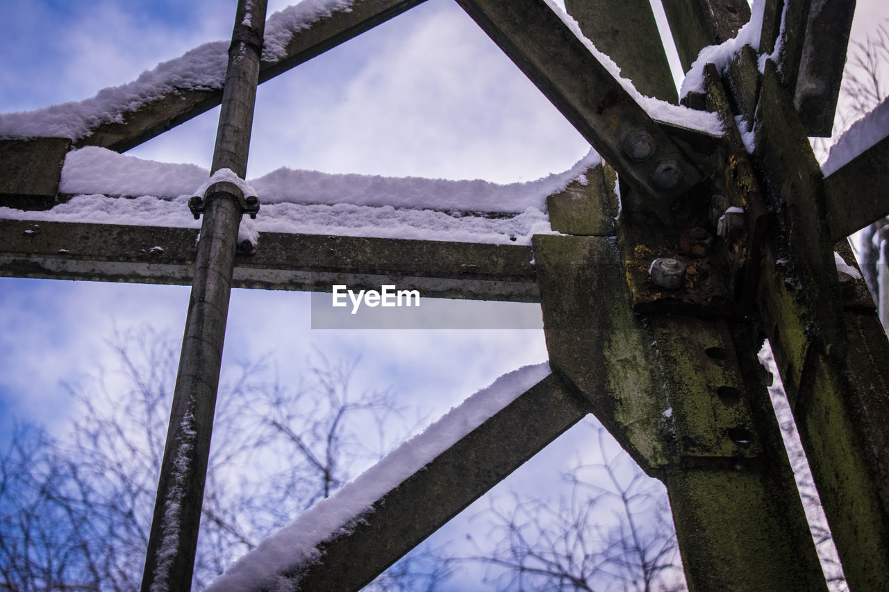 wood - material, no people, day, outdoors, winter, low angle view, close-up, snow, cold temperature, rusty, sky, tree, nature