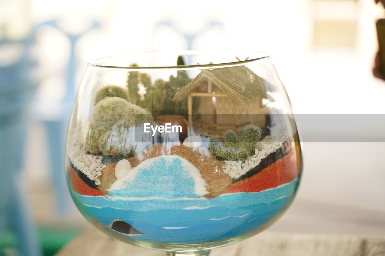close-up, focus on foreground, glass - material, transparent, drink, refreshment, day, glass, food and drink, nature, freshness, outdoors, still life, water, household equipment, architecture, table, built structure, holding, wineglass